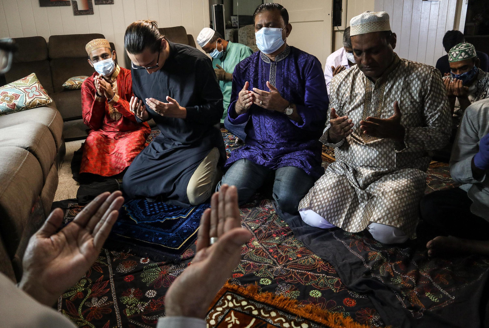 Muslims pray during an Eid-al-Fitr home congregational prayer in Honolulu, HI on May 23, 2020. Religious institutions are under lockdown to worshippers and visitors as a measure to regulate the spread of COVID-19. On Thursday, the city has allowed in-person spiritual services to reopen on O'ahu from June 5, 2020.