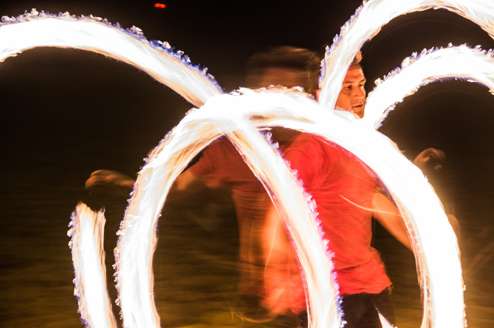 A Renegade Fire Tribe Hawaii fire dancer practices at Ala Moana Beach Park on February 10, 2017.