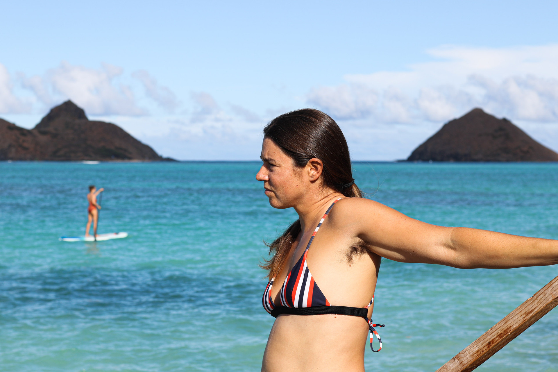 Rower Lia Ditton poses for a portrait showing her armpit hair on October 1, 2020 in Lanikai Beach, Kailua, HI. To her, the hair is a symbol of rowing in the sea for 86 days.