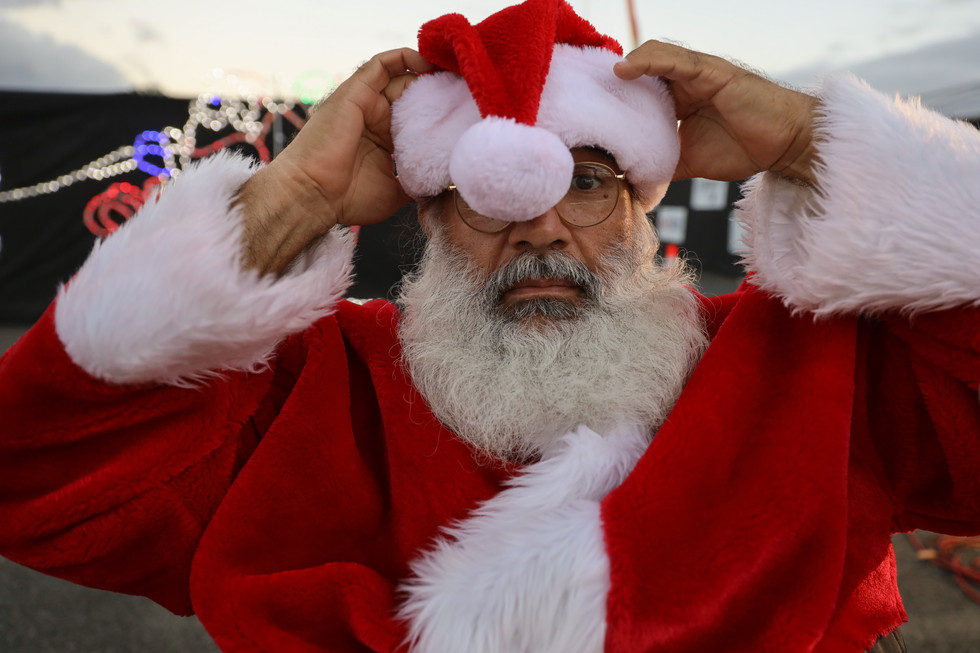 """Don Gonzales has dressed up as Santa Claus for the past five years and says it brings him joy to make children happy. """"I feel in my heart that this is what I was meant to do,"""" he says."""