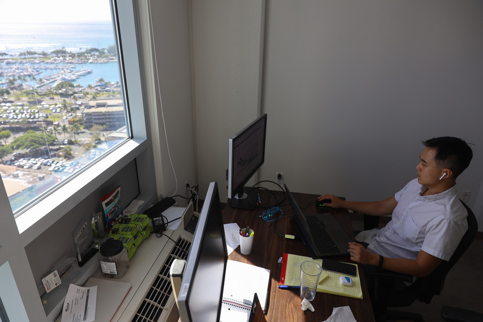 Richard Matsui, CEO of a solar company, kWh Analytics works from his home office at a condominium in Kaka'ako on Saturday, December 12, 2020. His usual schedule pre-pandemic was to work face to face with his employees at the office. However, following the closure of Bay Area due to the pandemic, he decided to move back to Hawaii. Now, He's one of many Bay Area workers who have decided to ride out the pandemic in the Hawaiian Islands.