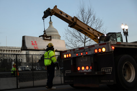 Steel fences, barricades as well as curious spectators today revolving the U.S Capitol after the riot on January 6, 2021.