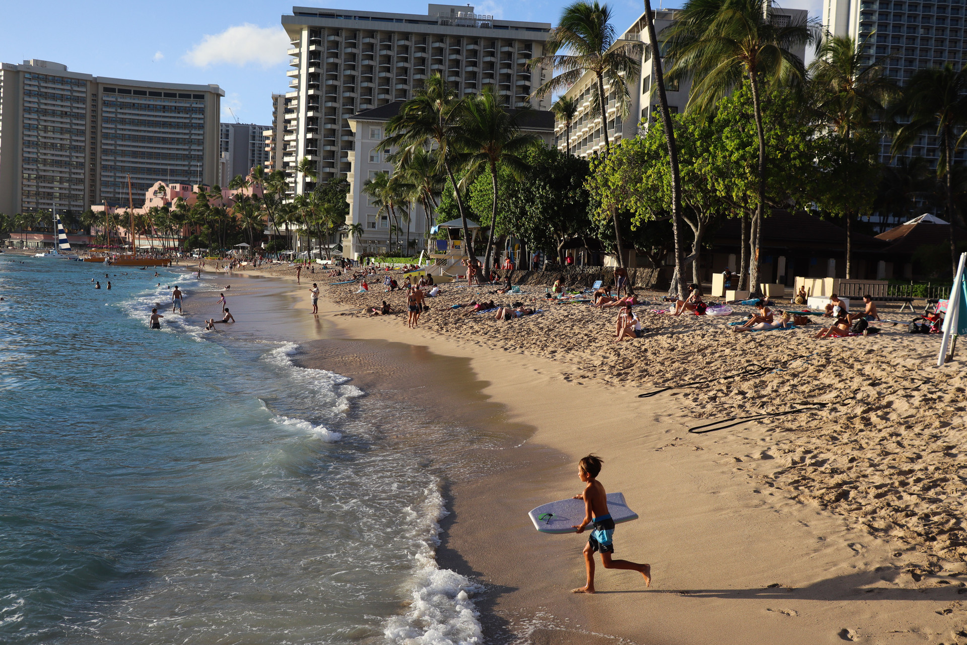 Tourists and residents gather at Waikiki Beach on November 20, 2020. The beach that was once deserted due to the pandemic is now seeing comparatively better crowd.