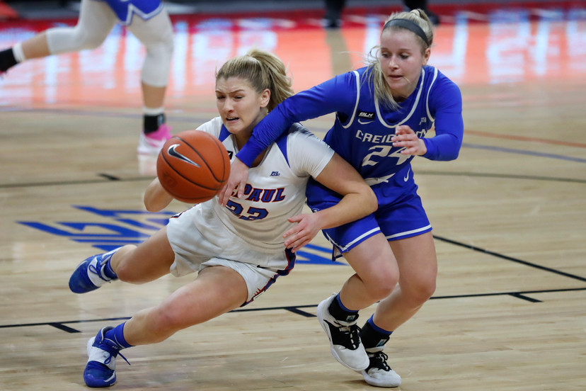 Creighton guard Chloe Dworak, right defends against DePaul's Jorie Allen during the first half of an NCAA college basketball game, Saturday, Feb. 20, 2021, in Chicago. (AP Photo/Shafkat Anowar)