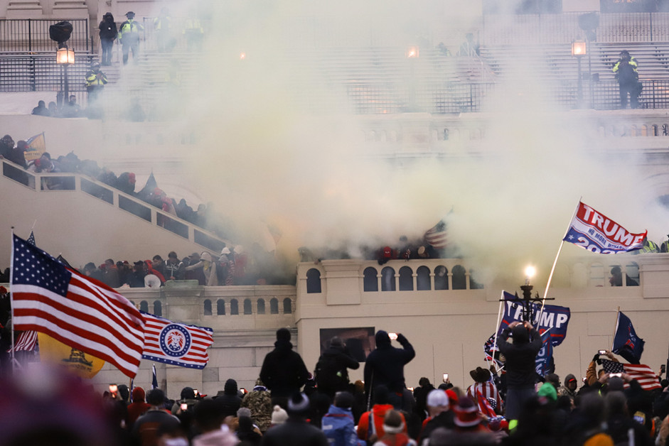 An explosion went off by a police force as Trump supporters clash on the Capitol Building in Washington, January 6, 2021.