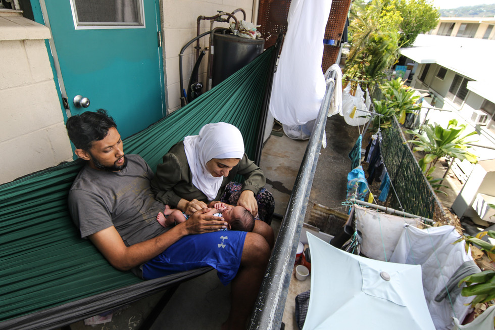 Dr. Arifur Rahman and his wife Radwa Elshennawy spend time with their first born at their residence in Honolulu, HI during the second stay-at-home order implemented by the government.