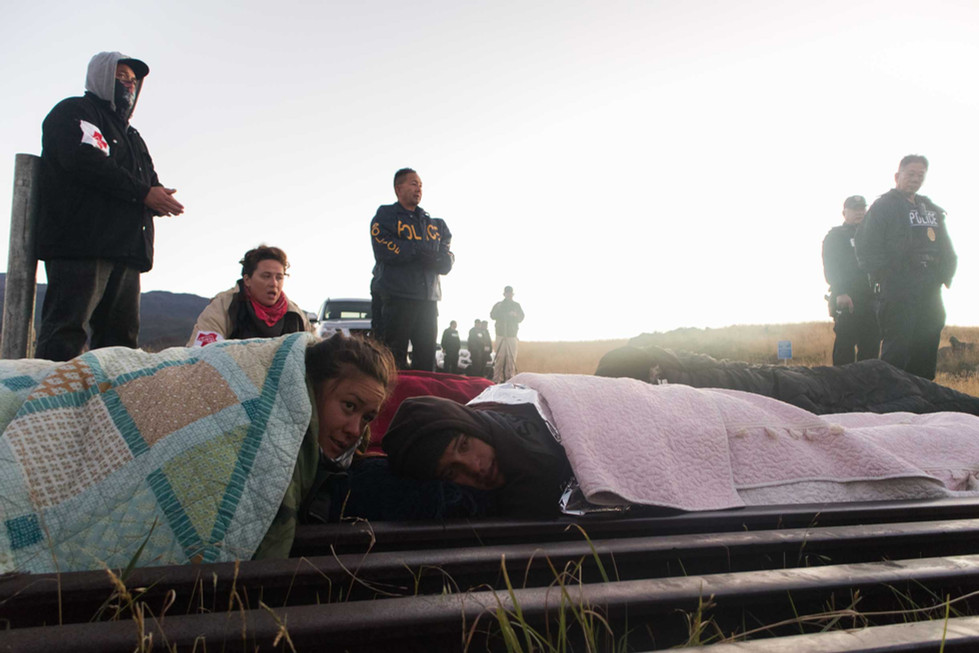 On the first day, seven activists chained themselves on the cattle guard to prevent the construction machinery from going to the summit.  Hawaiian activist, poet and writer Jamaica Osorio and her significant other Malia Hulleman chained themselves to a cattle guard at the base of Mauna Kea Access Road in an effort to block construction workers from transporting heavy machinery up to the Mauna kea Summit for construction of the Thirty Meter Telescope on July 15, 2019.