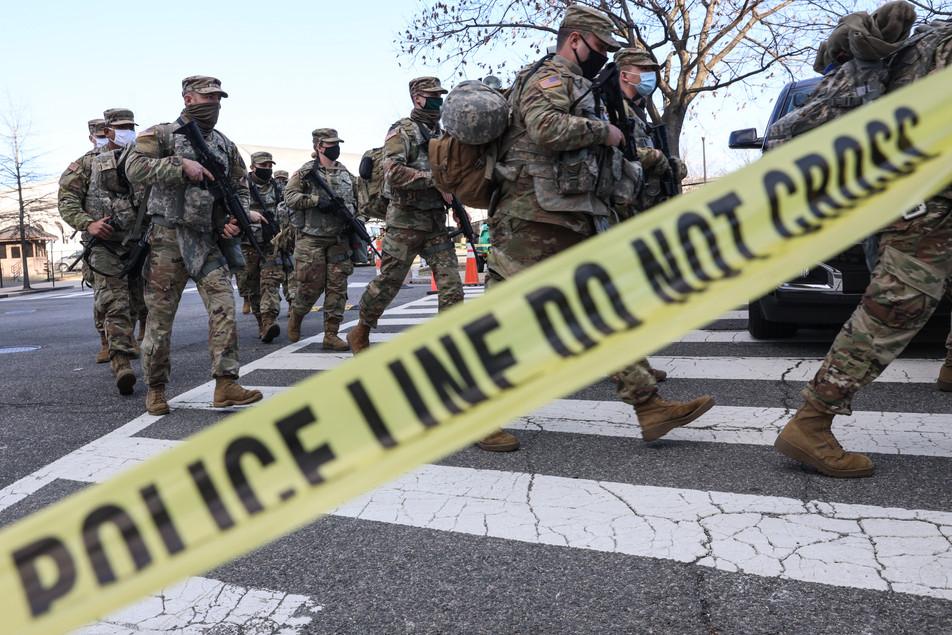 National Guard troops walk past the U.S. Capitol in Washington, D.C., U.S., on Saturday, January 20, 2021.