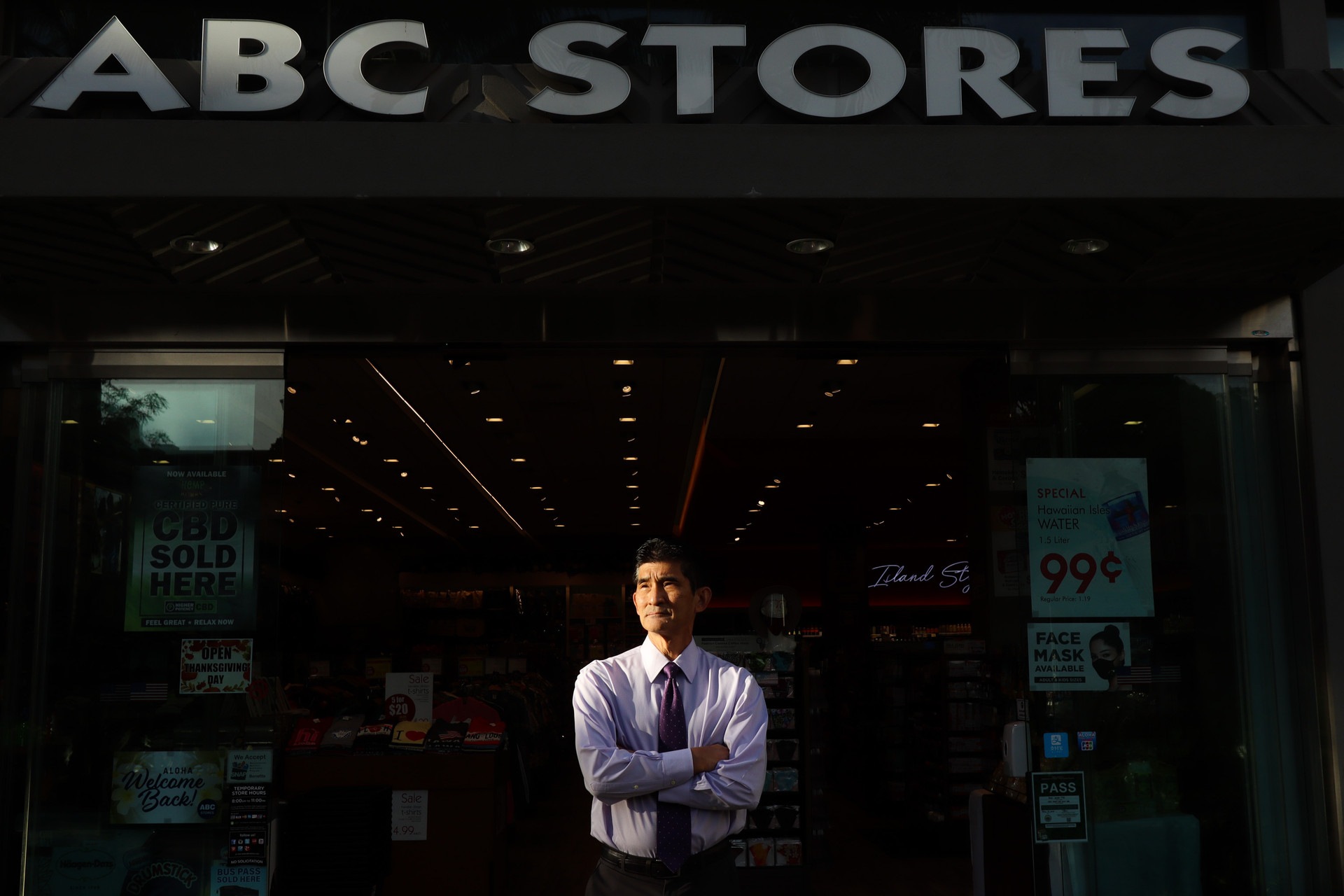Paul Kosasa, owner of ABC Stores, a Honolulu based chain convenience store poses for a portrait infront of the storefront at International Market Place, Waikiki, Honolulu on November 20, 2020. The first ABC Store was opened in Waikiki in 1964 by is parents, Minnie and Sidney Kosasa. CREDIT: Shafkat Anowar for The Wall Street Journal.