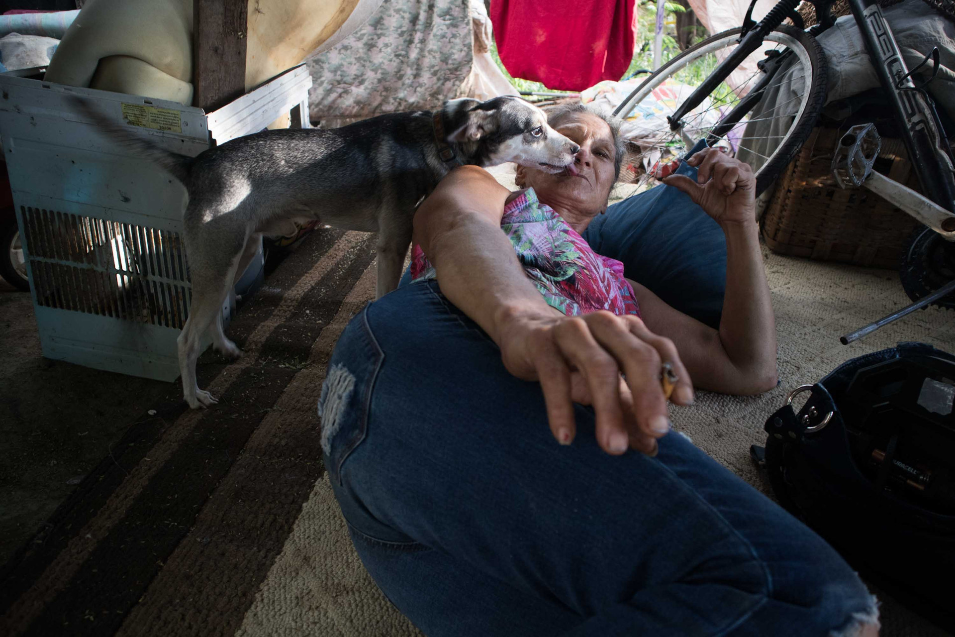 Barbara Meachal plays with her dog inside her house. She has been living in the shelter for the past 5 years.