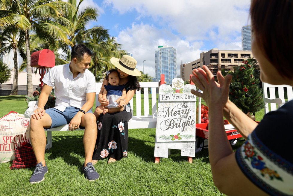 Richard Matsui and wife Christine Guo tries to pose for a portrait with their 11-month daughter Maya while grandma Kay Matsui tries to cheer at a small Christmas decoration in Kaka'ako, Hawai'i on Saturday, December 12, 2020. Matsui grew up in Honolulu, Hawai'i and upon graduating from a mainland college, he moved to San Francisco. He and his wife lived there for the past 10 years but the chance to work remotely brought them back to Hawai'i.