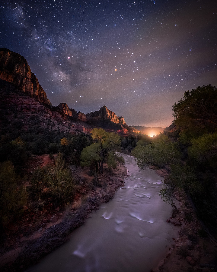 The milky way shining bright over the Virgin River in Zion National Park.