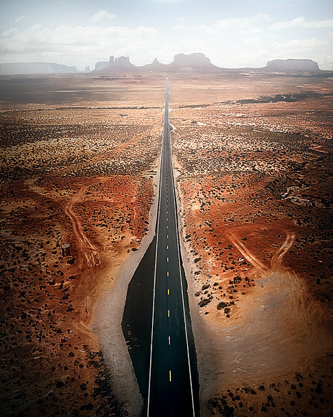 An aerial shot of the famous road leading to Monument Valley.
