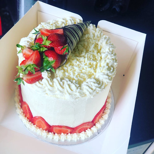 Strawberry and cream with vanilla sponge cake with chocolate accent from £55.00