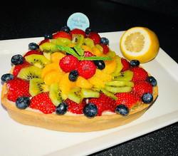 Fresh glazed fruit heart shaped tart wit