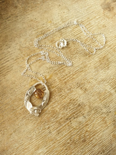 Sterling silver horse shoe floral pendant