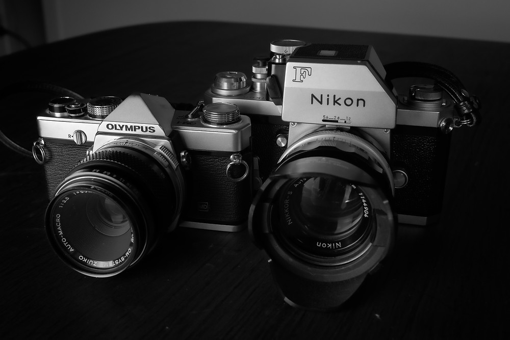 The Olympus OM-1 (1972- ) and the Nikon F.  (1959-73)