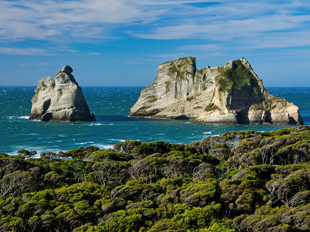 An unconventional image of the Archway Islands from the windswept headland above the beach. At high tide much of Wharariki beach, which extends out to the islands, is under water.