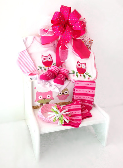 White wooden step stool with baby clothing and accessories.
