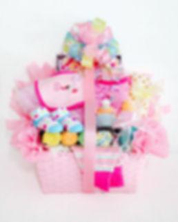 cupcake motif baby girl gift arrangement
