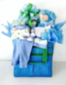 Blue tote bag filled with new baby boy gifts.