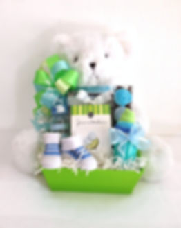 Plush teddy bear with a gift box of new baby boy gifts