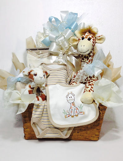 Baby Boy gift basekt with plush giraffe, appliqued clothing and new baby gift items.