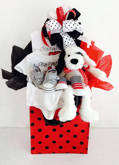 Tote bag filled with firefighter themed gifts for new baby boy