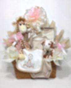 Plush giraffe and appliqued baby cloths gift arrangement