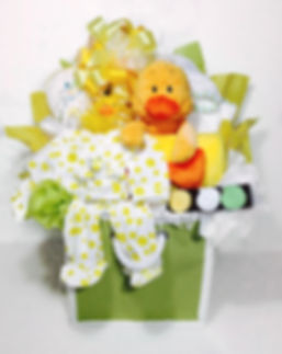 Duck themed storge container filled with bed and bath gifts for twin babies.