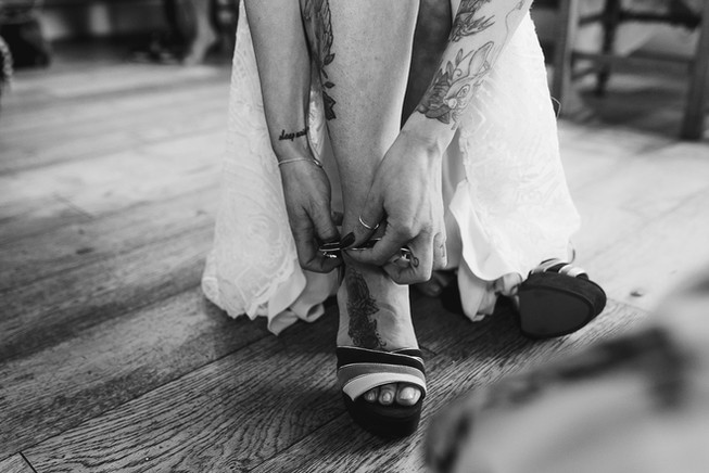 bride putting on shoes tattoo