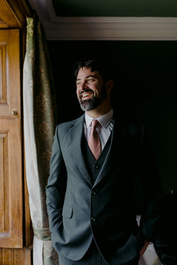 groom in tailor made suit green