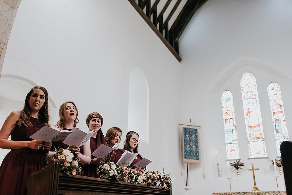 bridesmaids singing hymns