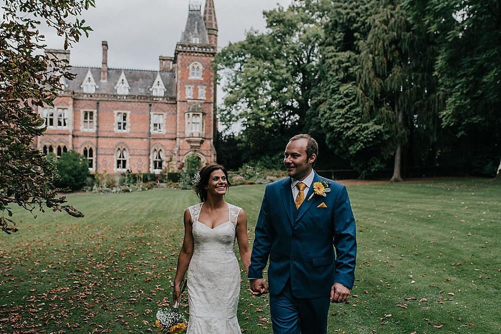 unique warwickshire wedding venue couple walking