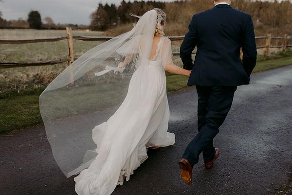 bride and groom running wedding photographer