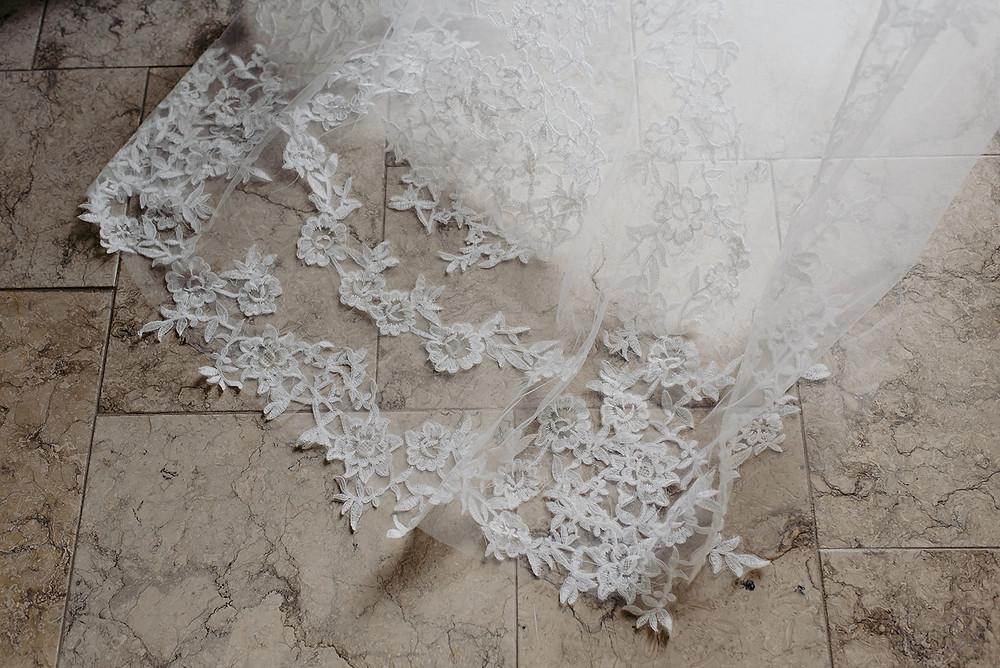 close up photo of lace detail on veil