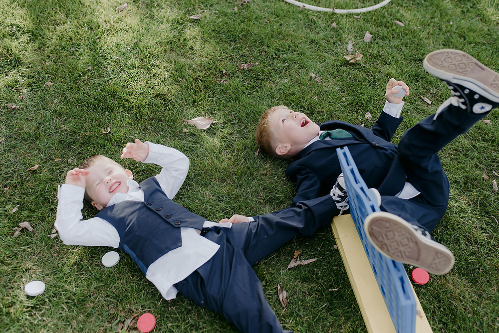 page boys laughing on the grass at sulgrave manor