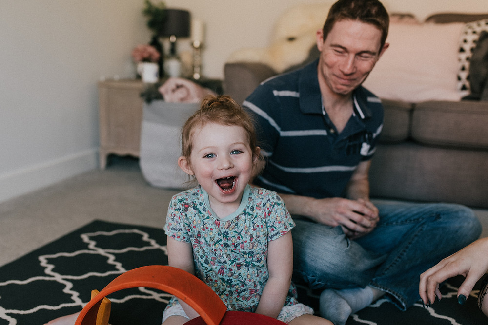 unposed photography of family in their home