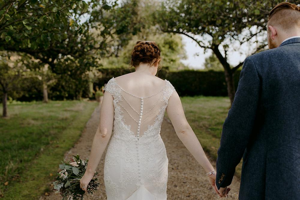 red head bride walking away beautiful dress