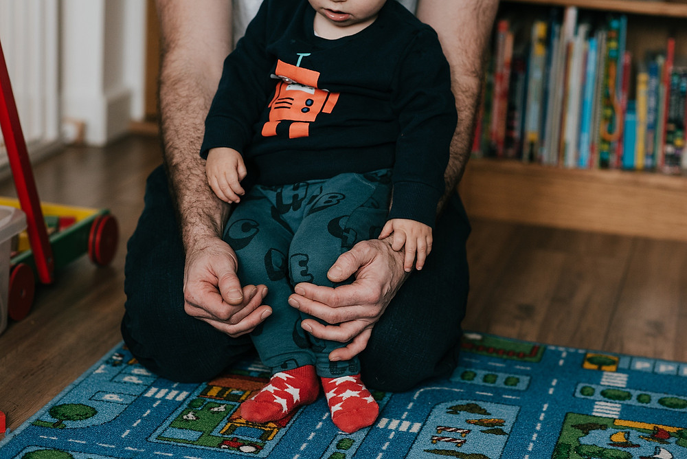 father and son in playroom