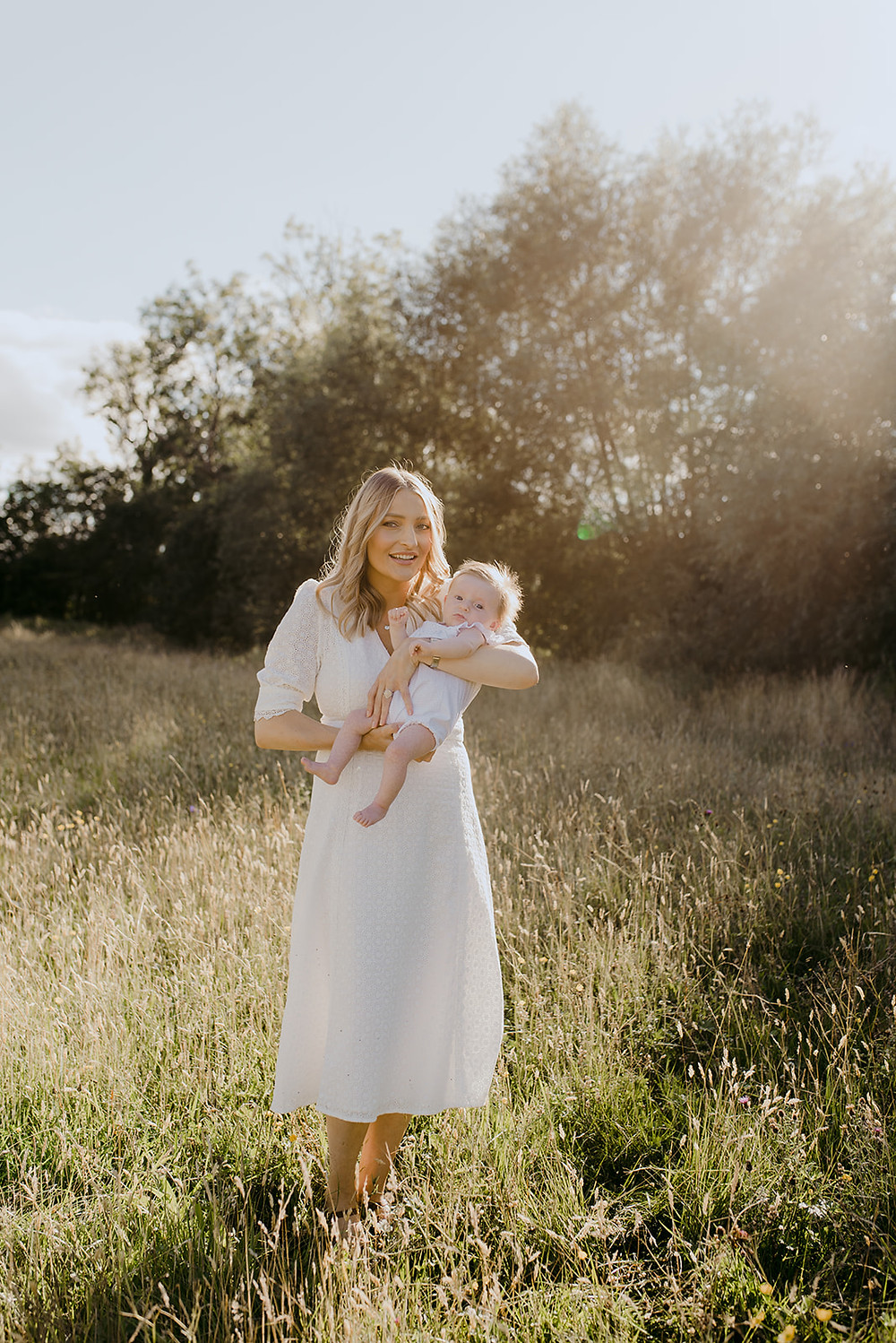 outdoor sunset photography with newborn