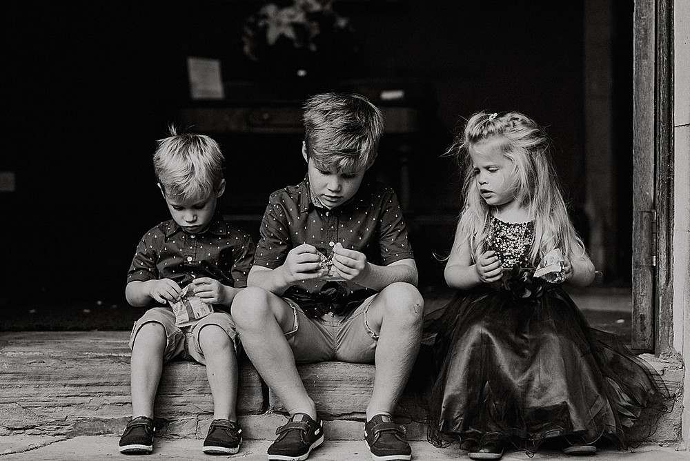 candid moment of children at wedding