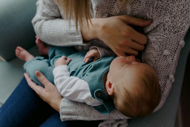 mum holding newborn warwickshire photographer