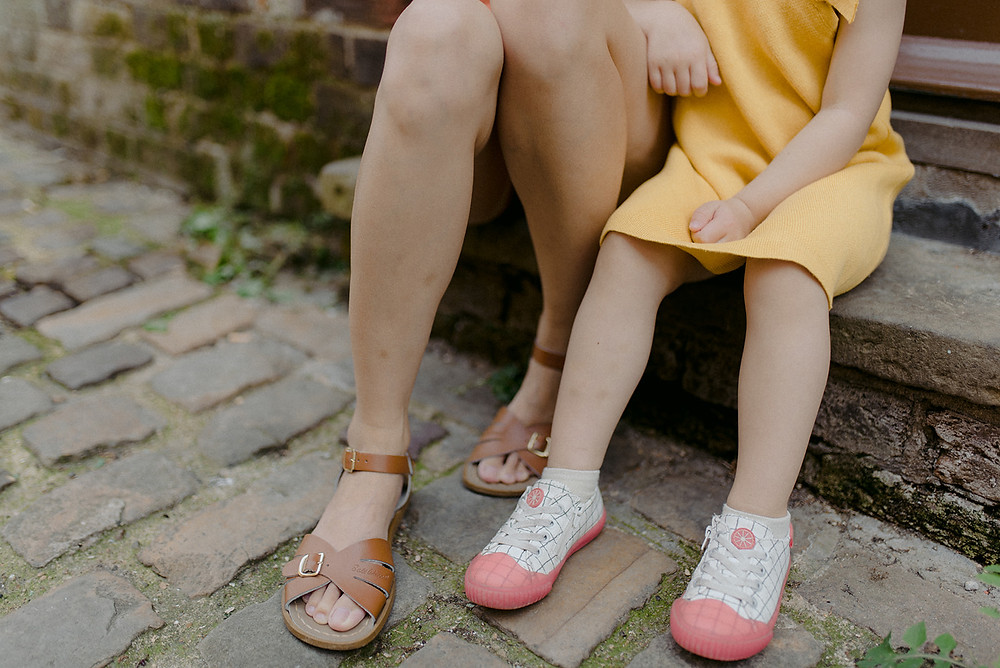 Mum and daughter feet on outdoor photoshoot