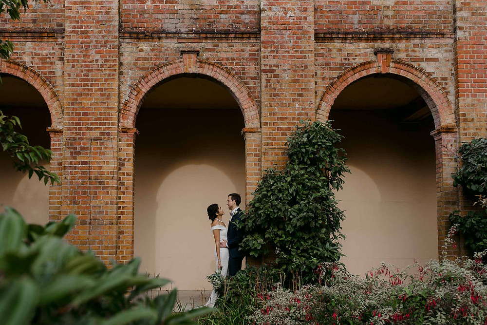 couple wedding under arch london