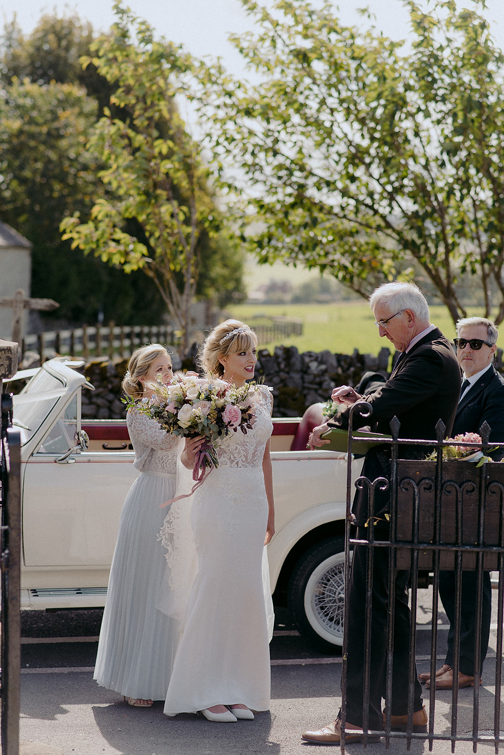 bride arrival at chapel on sunny day