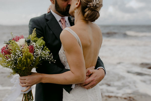 wedding couple kiss by the sea