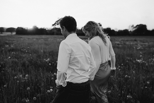 black and white couple photo on road