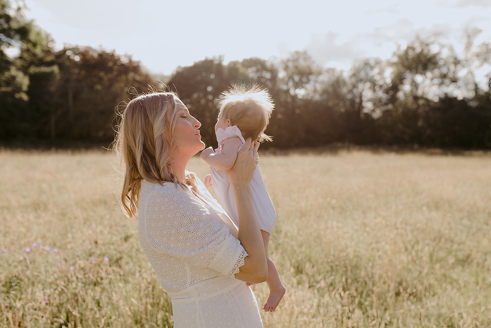 mother and baby newborn photoshoot outdoors