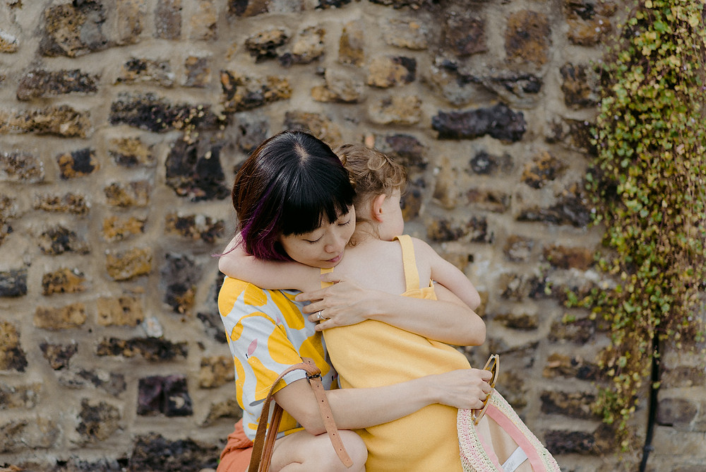 hugging documentary family photography